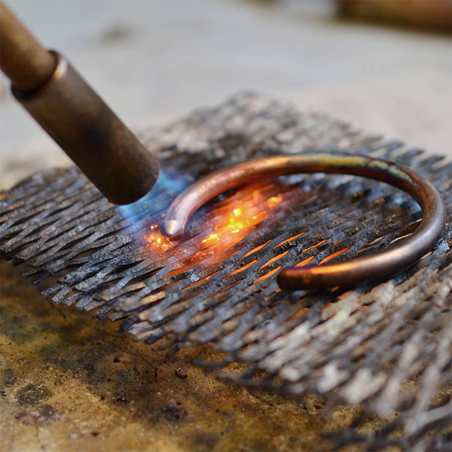 The bracelets are precision turned by our aerospace engineers in Hertford,  before being flame heated, forged, buffed and polished by our silversmith Dave.